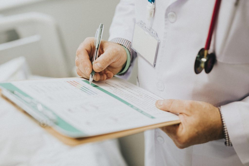 physician-noting-down-symptoms-patient-scaled